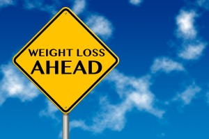 bigstock-Weight-Loss-Ahead-Sign-33359255