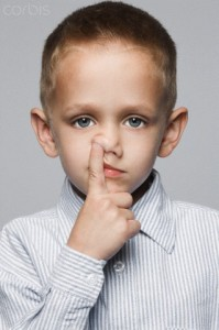 Little boy picking his nose --- Image by © Robert Recker/Corbis
