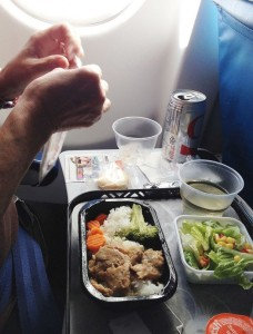 Man-eating-a-meal-in-his-airline-seat-during-the-flight