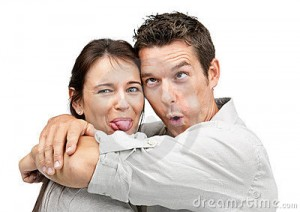 couple-making-funny-faces-16450135