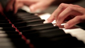 stock-footage-two-hands-playing-a-gentle-piece-on-a-beautiful-grand-piano-a-recording-of-the-reflection-using-a